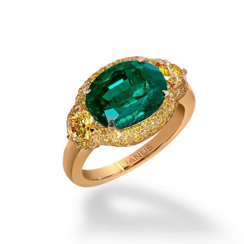 Haute joaillerie collection 3.719 carat, old mine Colombian emerald ring, accented by two brilliant cut, fancy vivid yellow diamonds