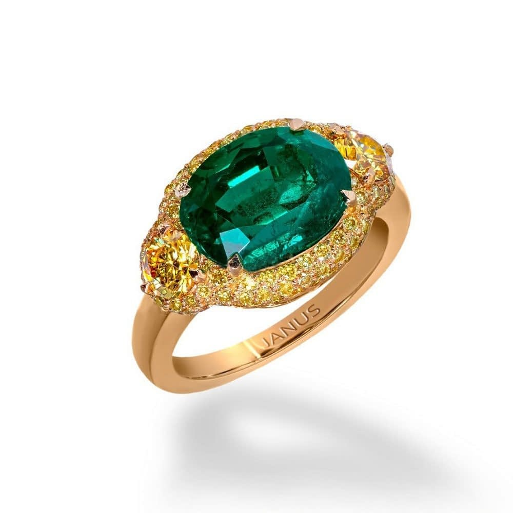 Jewelry and art 3.719 carat, old mine Colombian emerald ring, accented by two brilliant cut, fancy vivid yellow diamonds