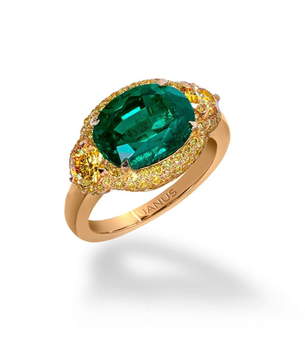 3.719 carat, old mine Colombian emerald ring, accented by two brilliant cut, fancy vivid yellow diamonds