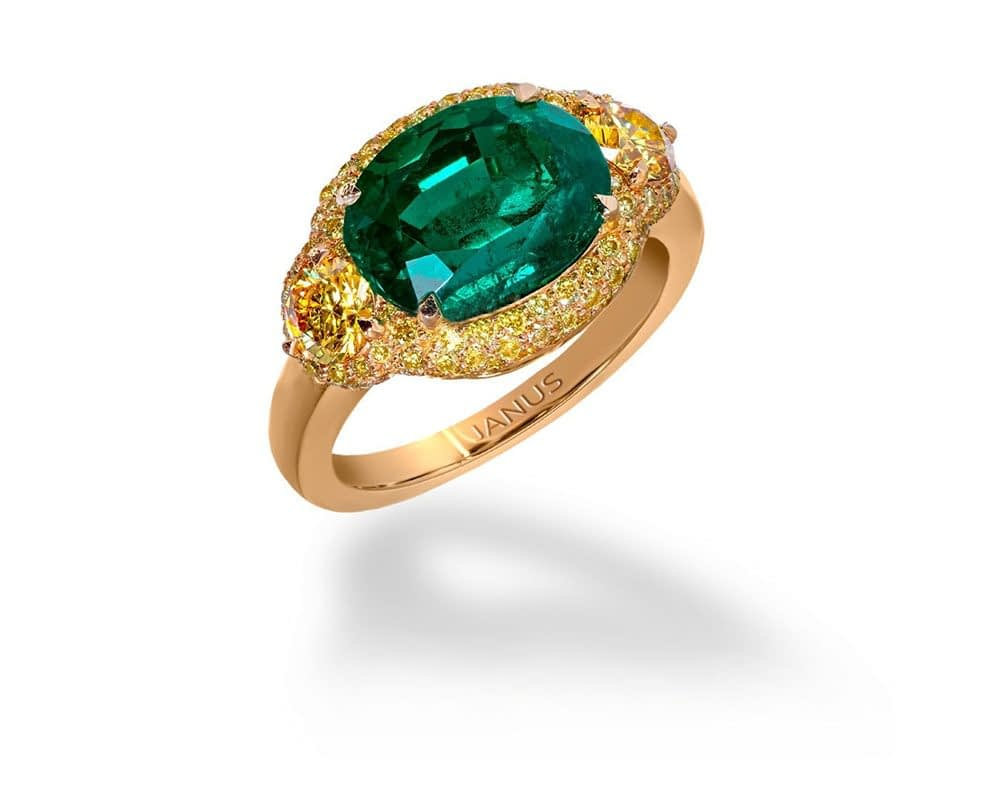 Jewelry creations 3.719 carat, old mine Colombian emerald ring, accented by two brilliant cut, fancy vivid yellow diamonds
